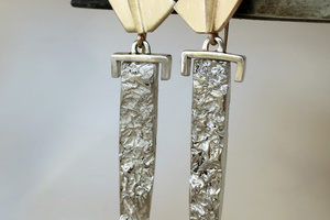 "14K yellow gold and silver ""sword"" earrings."