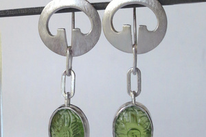 Silver and carved peridot earrigs.