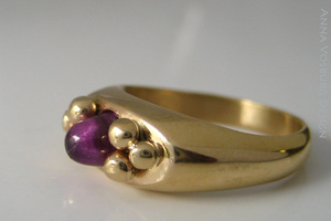 Hand made 18K yellow gold and lab grown alexandrite ring.