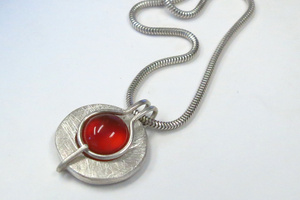 "Silver and carnelian pendant featuring my ""fold over"" setting."