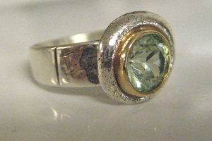 14K yellow gold, hand textured sterling silver ring featuring green spinel.