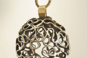 Hand made silver lace pendant with 14K gold accent.