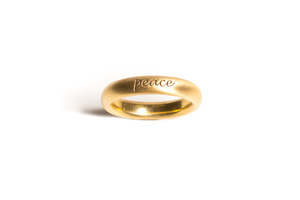 Peace ring in 18 karat yellow gold
