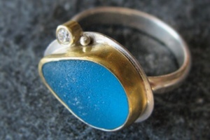 Turquoise sea glass with gold and diamond.